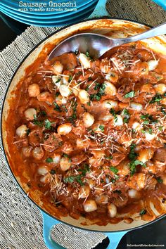 This Sausage Gnocchi with Tomato Alfredo Sauce recipe is combined with gnocchi, sausage, fresh basil and a creamy tomato sauce!