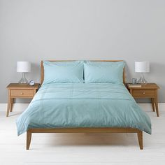 duck egg for sweet dreams, picture a teal-grey feature wall behind the bed