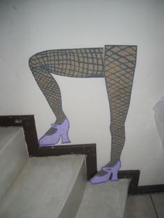 """Rocky Horror"" legs..easy to make.Just cut out forms of legs from cardboard,paint ""stockings"" or use real stockings.Stick to wall or staircase"