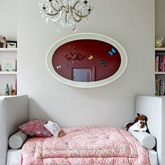 Proof that grown-up taste can co-exist with kids' rooms? Bodil Blain's daughter's bedroom in Bayswater (designed by Fiona Parke) which features a Damien Hirst artwork above the Kelly Wearstler-inspired bed.