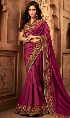 8940a20b18586  designersareeswithprice  expensivedesignersarees Steal the hearts away  with this purple color embroidered silk sari.