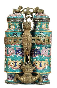 Rare Chinese cloisonne champion vase Qing dynasty (1644-1911), two metal and enamel vases with dragon or possibly taotie motif encased in brass mounts with traditional falcon atop bear and brass entwined dragons adjoining lids. From Columbus Museum, Columbus, Georgia; sold to benefit the acquisitions fund.