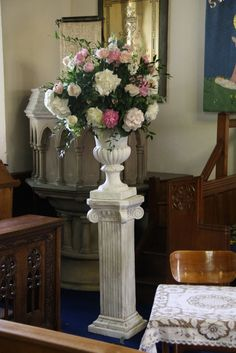 Two voluptuous designs in alabaster urns set on pedestals were filled with Peonies, Roses, Stocks and Hydrangeas with lots of foliages