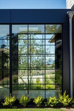 Black framed windows breezeway Modern Breezeway ideas