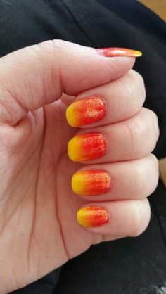 Yellow with red ombre and gold glitter. Looks like fire!! By Brenna