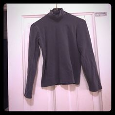 Armani made in Italy gray turtle neck Gray turtle neck! Great quality!  Made in Italy ! 95% wool 5% elastin gentle hand wash , pull back into shape! Do not tumble dry . Armani Tops