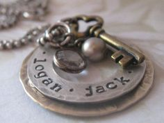Very cute, LOVE the key detail! Personalized Jewelry -- Hand Stamped Mommy Necklaces -- Sterling Silver and Brass Stacked Washers with Brass Key Charm.