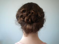 elegant curly gibson tuck hairstyle