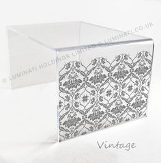 vintage laser etched design on this contemporary acrylic table from luminaticouk acrylic furniture uk
