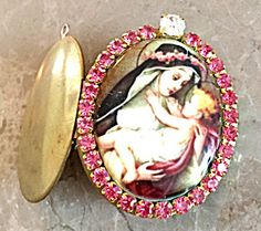 Gorgeous one of a kind Religious Jewelry: Large porcelain cameo featuring Saint Rose of Lima holding the Christ child Jesus, surrounded by deep pink rhinestones