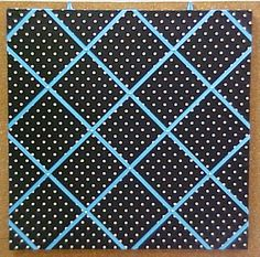 """Black with White Polka Dots with turquoise Crisscross message ribbons custom fabric covered cork bulletin board.  Code 10232   24"""" x 24""""  $75.90"""