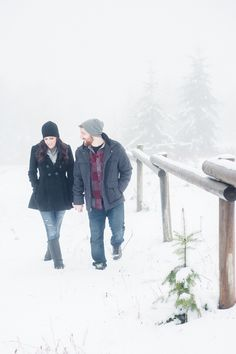 A Romantic Walk in the Snow | Imago Dei Photography | Warm and Cozy Snowfall Engagement Portraits