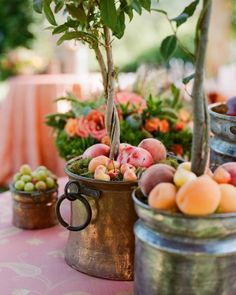 Festive Fruit Decor.A cocktail area's tall bistro tables are topped with Italian bay topiaries in copper pots, with local fuzzy peaches, nectarines, apricots, and tiny crabapples at their bases.