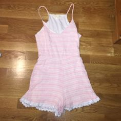Pink and white Aztec romper This cute romper is brand new never been worn! It's a great outfit for the summer and even the spring with a nice sweater or jean jacket! Other