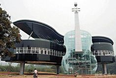 Piano and Violin Building located in An Hui Province, China. Brilliance. :) Architecture Design, Beautiful Architecture, China Architecture, Building Architecture, Acoustic Architecture, Creative Architecture, Conceptual Architecture, Famous Architecture, Installation Architecture