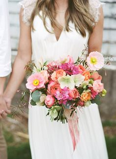 spring wedding bouquet, photo by Lauren Fair Photography http://ruffledblog.com/stonebrook-farms-bohemian-wedding #weddingbouquet #flowers #springwedding