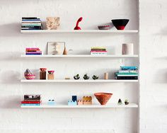 Everything You Need For a Skillfully Styled Bookshelf // white shelves, open shelving