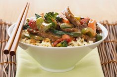 what you need  1/4cup KRAFT Asian Toasted Sesame Dressing  1/2lb. beef sirloin steak, thinly sliced  3cups frozen Asian-style stir-fry vegetables  2cups hot cooked long-grain white rice
