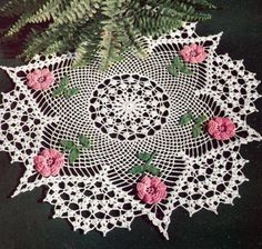Beautiful six-sided star thread crochet doily with pink flowers.  #crochet #doily