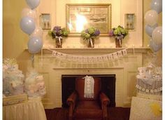 Blue and white balloons next to fire place