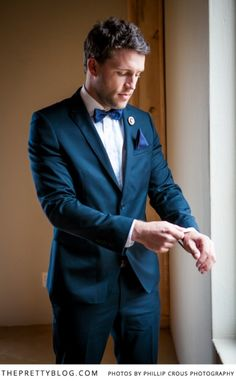 Handsome groom with navy suit & bow tie | Photographer: Phillip Crous Photography