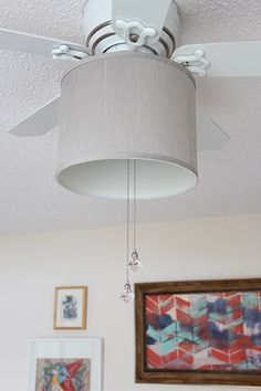 a drum shade to your ceiling fan in 5 minutes! Add a drum shade to your ceiling fan! It only takes 5 minutes with this easy DIY!Add a drum shade to your ceiling fan! It only takes 5 minutes with this easy DIY! Ceiling Fan Globes, Ceiling Fan Chandelier, Ceiling Lights, Ceiling Fan Shades, Chandelier Ideas, Ceiling Ideas, Lamp Shades, Ceiling Fan Makeover, Lamp Makeover