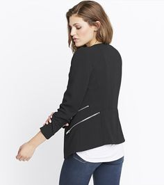 Top off your look with this gorgeous black side zipper over piece!