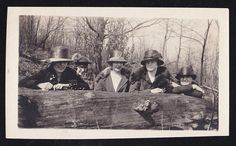 Old Vintage Antique Photograph of Five Women In Big Hats Looking Over Tree Log