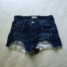 High Waisted Shorts High waisted jean shorts. White lace on the front. Worn once. Rue 21 Shorts Jean Shorts
