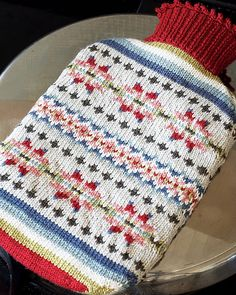 Ravelry: # 31 Fair Isle Hot Water Bottle Cover pattern by Debbie Bliss