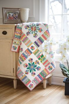 Designer B.J. Santema hand appliquéd and hand quilted all her quilt blocks. Each block features a bouquet of pastel printed flowers on a white background. This is the quilt for those who enjoy relaxing with some evening hand crafts. Look for Oh Lolly Lolly in Scrap Quilts Spring '15.