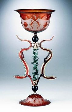 Lizards- How the Lizard Gods Keep the Sky From Falling, 1996 by   Robert Mickelsen  Lampworked borosilicate glass, sandblasted relief.