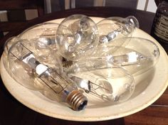 Here's a bright idea.  Place lightbulbs in a decorative bowl to create a funky, industrial look.  #hpmkt