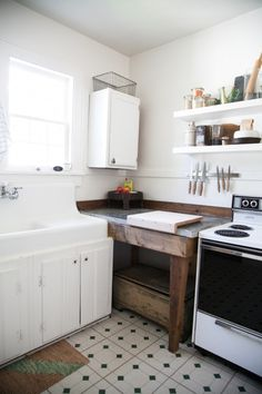 via Design Sponge {Love this upgrade to an old kitchen - would even work for a Rental since they always have odd spaces}