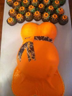 I LOVE this!! Belly cake and Cupcake camo idea. Dress in baby blue or keep orange but I love this!