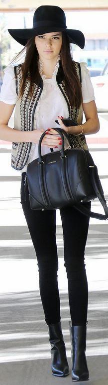 Kendall Jenner: Vest – Topshop  Shoes – Celine  Purse – Givenchy