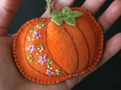 orange wool felt pumpkin with hand embroidered purple flowers orange wool felt pumpkin with hand embroidered purple flowers Felt Embroidery, Felt Applique, Pumpkin Applique, Autumn Crafts, Fall Felt Crafts, Fall Sewing, Felted Wool Crafts, Felt Ornaments, Felt Halloween Ornaments