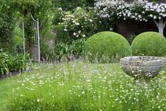 Font Garden with clipped Box in Pudding shapes: photograph by Marianne Majerus