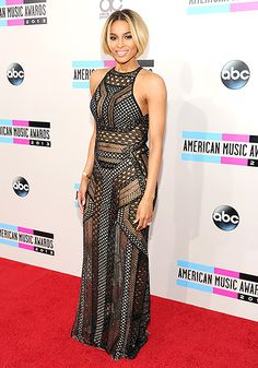 Ciara in an intricate, black, nude and sheer gown that bared her midriff and toned legs at the 2013 AMAs