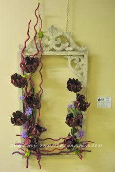 """""""Ruffled Curtains"""" The frame is a re-purposed mirror frame accented with dyed branches. Parrot tulips, reindeer moss and status. This was one of several pieces on exhibit at my last art show. Art Floral, Ruffled Curtains, Flower Decorations, Table Decorations, Parrot Tulips, Floral Designs, Ikebana, Botanical Art, Installation Art"""