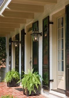 I love the southern, Acadian vibe. Floor to ceiling windows, black shutters, brick porch, ok everything! Just have to be sure those are real gas lanterns New Orleans Decor, New Orleans Homes, New Homes, Brick Porch, Front Porch, Porch Windows, Front Entry, Estilo Colonial, Gas Lanterns
