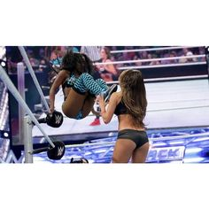 Paige and AJ Lee are victorious against the Bella Twins WWE... ❤ liked on Polyvore featuring wwe and wwe tops