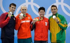 Michael Phelps, left, with Laszlo Cseh, Joseph Schooling, and Chad Le Clos.