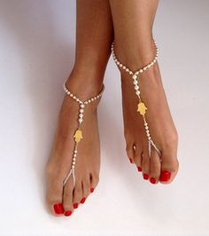 Check out this item in my Etsy shop https://www.etsy.com/listing/222731425/barefoot-sandals-ivory-pearl-wedding