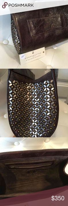 """Calleen Cordero """"Wren"""" Leather Clutch By celebrity favorite, L.A. designer, Calleen Cordero, this (brand new with tags) Italian leather handmade Wren clutch features an invisible magnetic closure, solid nickel and solid brass meticulous artwork, and an outside hand strap. 11""""W x 7""""H x 3.5""""D. Zipper side pocket inside. Pristine, suede interior. See Calleen Cordero website, where it's listed for $550. After purchasing it, I decided the brown leather color was too dark for me. However, it's…"""