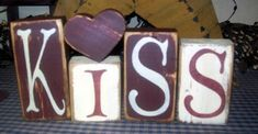 THIS BLOCK SET MEASURES FROM 3, 4, 4 1/2, 5AND A HEART. I PAINTED THEM BURGUNDY AND ANTIQUE WHITE,THE SECOND SET IS BLACK THEN BURGUNDY, MAUVE AND ANTIQUE TAN FOR THE TOP COATS THEN SANDED, STAINED AND SEALED FOR THE OLE PRIM LOOK.    COLOR  CHOICES ARE AVAILABLE. JUST LET ME KNOW YOUR COLOR CHOICE IN THE EXTRA BOX BELOW.    PLEASE LET ME KNOW WHICH COLOR SET AT CHECK OUT, IF NONE IS STATED, THE FIRST SET WILL BE SENT.