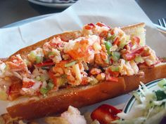 Maine Lobster Roll. 'The perfect lobster roll means a maximum amount of lobster-meat chunks (up to 450g or more) mixed with mayo or butter and stuff ed into an absurdly small hot-dog bun. It's typically served during summer at a seasonal 'lobster shack' – a roadside stand with walk-up window service and a handful of outdoor picnic benches for seating.' http://www.lonelyplanet.com/usa/new-england/maine