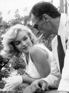 Marilyn Monroe with Arthur Miller in New York photographed by Sam Shaw, 1957.