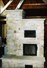 Figure Masonry heaters, with their enormous thermal mass, are designed to burn very hot, then store and slowly release heat. Although more expensive than prefabricated metal fireplaces, they provide a reliable high-performance wood-burning hearth.