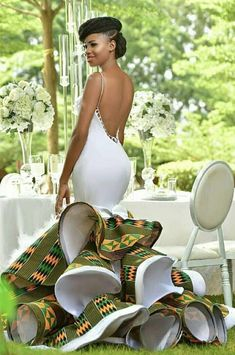 Most of the time, African wedding dresses are more captivating and colorful than the white, Western-world bridal attire. Let's have a look: African Prom Dresses, Latest African Fashion Dresses, African Inspired Fashion, African Print Fashion, Africa Fashion, African Prints, African American Fashion, Short Dresses, Ankara Fashion
